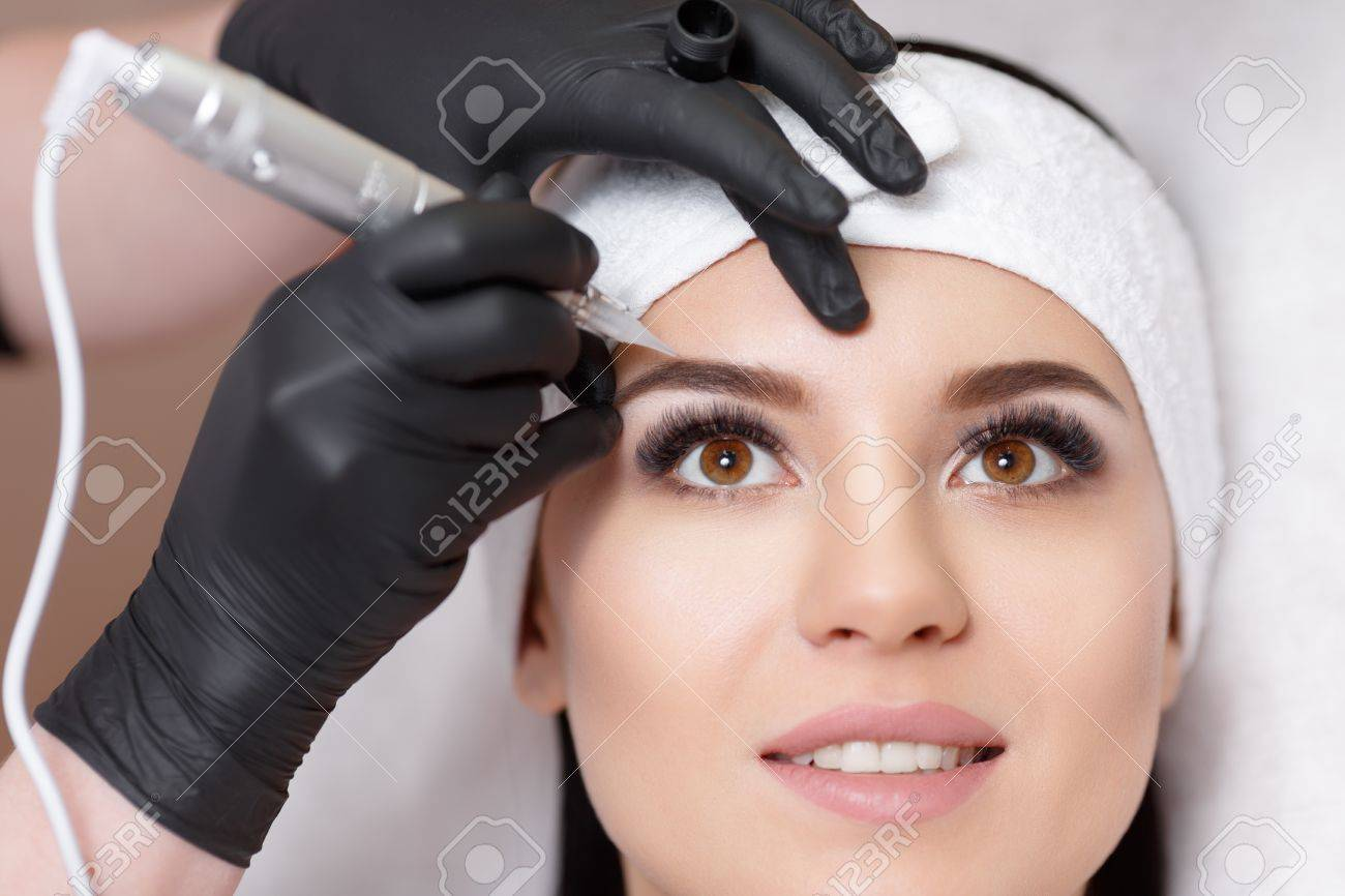 Permanent Makeup. Permanent Tattooing Of Eyebrows. Cosmetologist ...