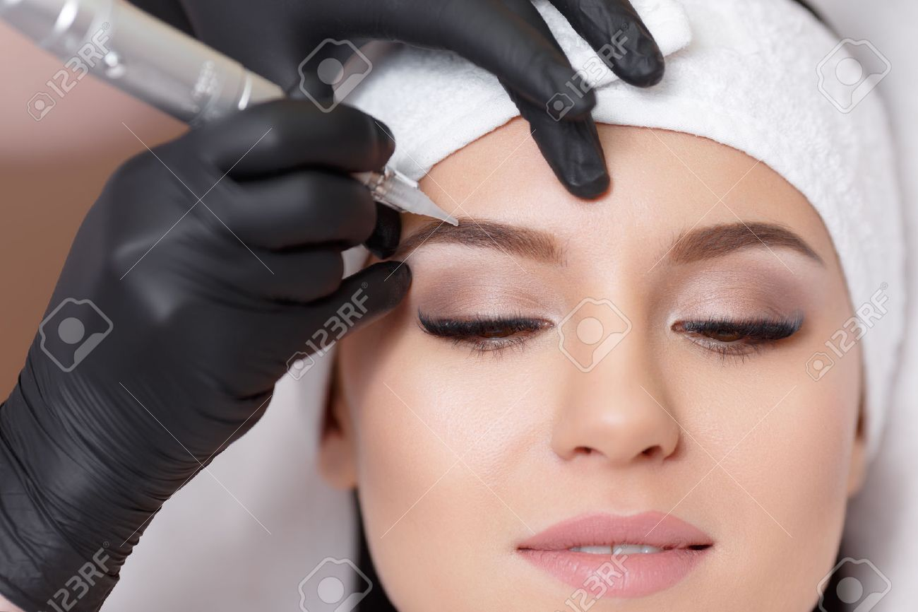 permanent makeup tattooing of eyebrows stock photo picture and