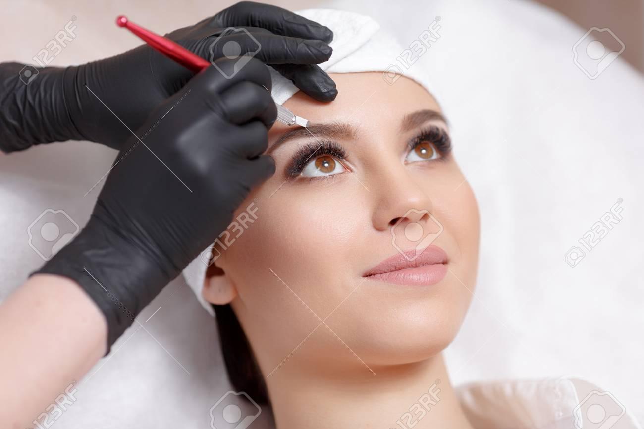 Permanent makeup eyebrows. - 68930742