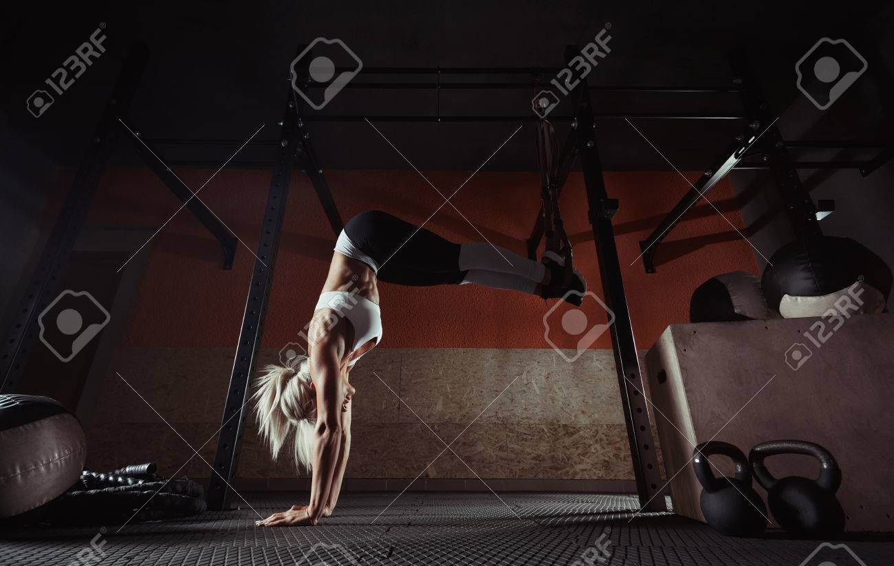 Fitness woman workout on the TRX in the gym - 81878483