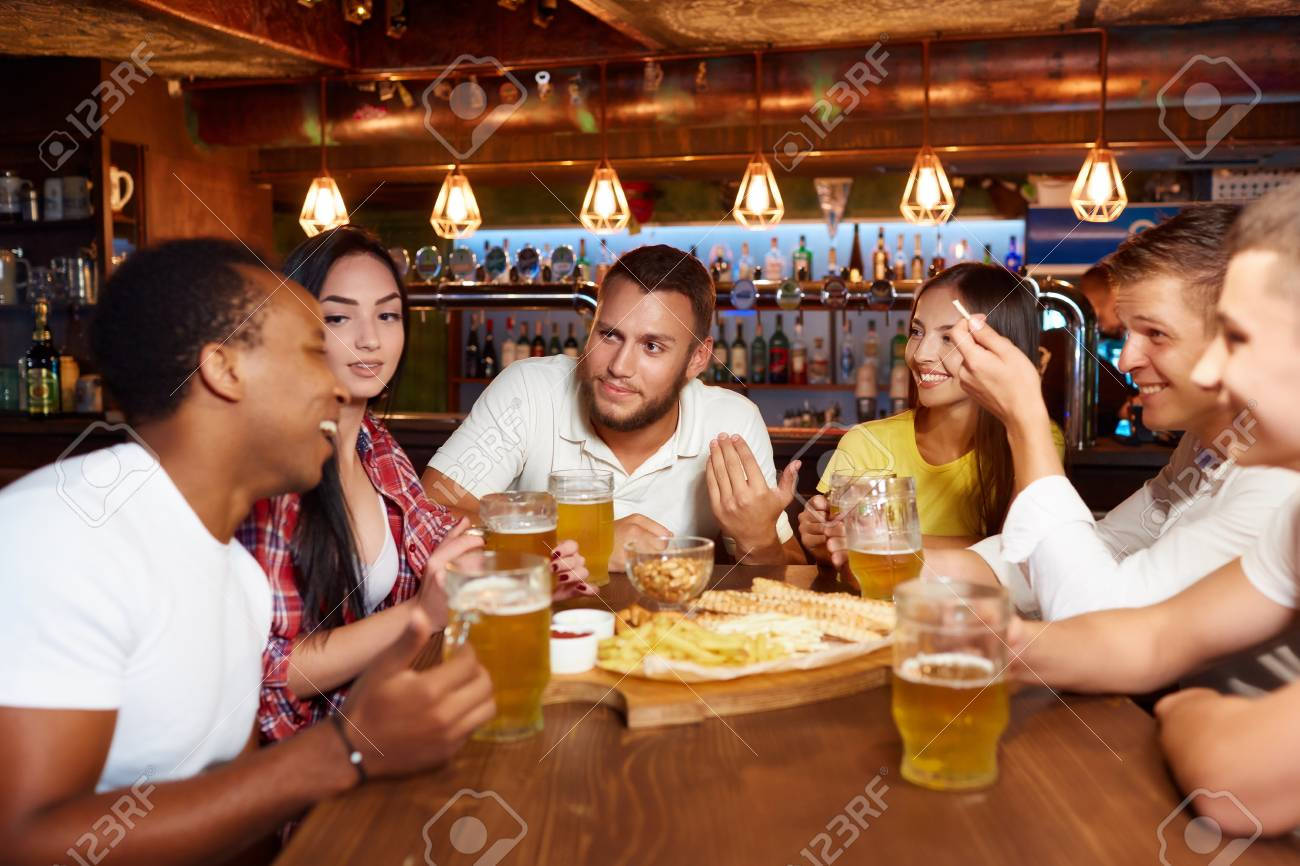 Happy friends group drinking beer at brewery bar restaurant. - 107927660
