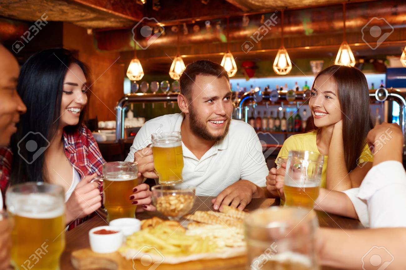 Happy friends group drinking beer at brewery bar restaurant. - 107927751