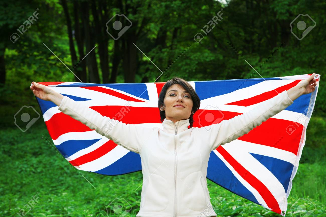 Young woman holding flag of Great Britain Stock Photo - 12879667