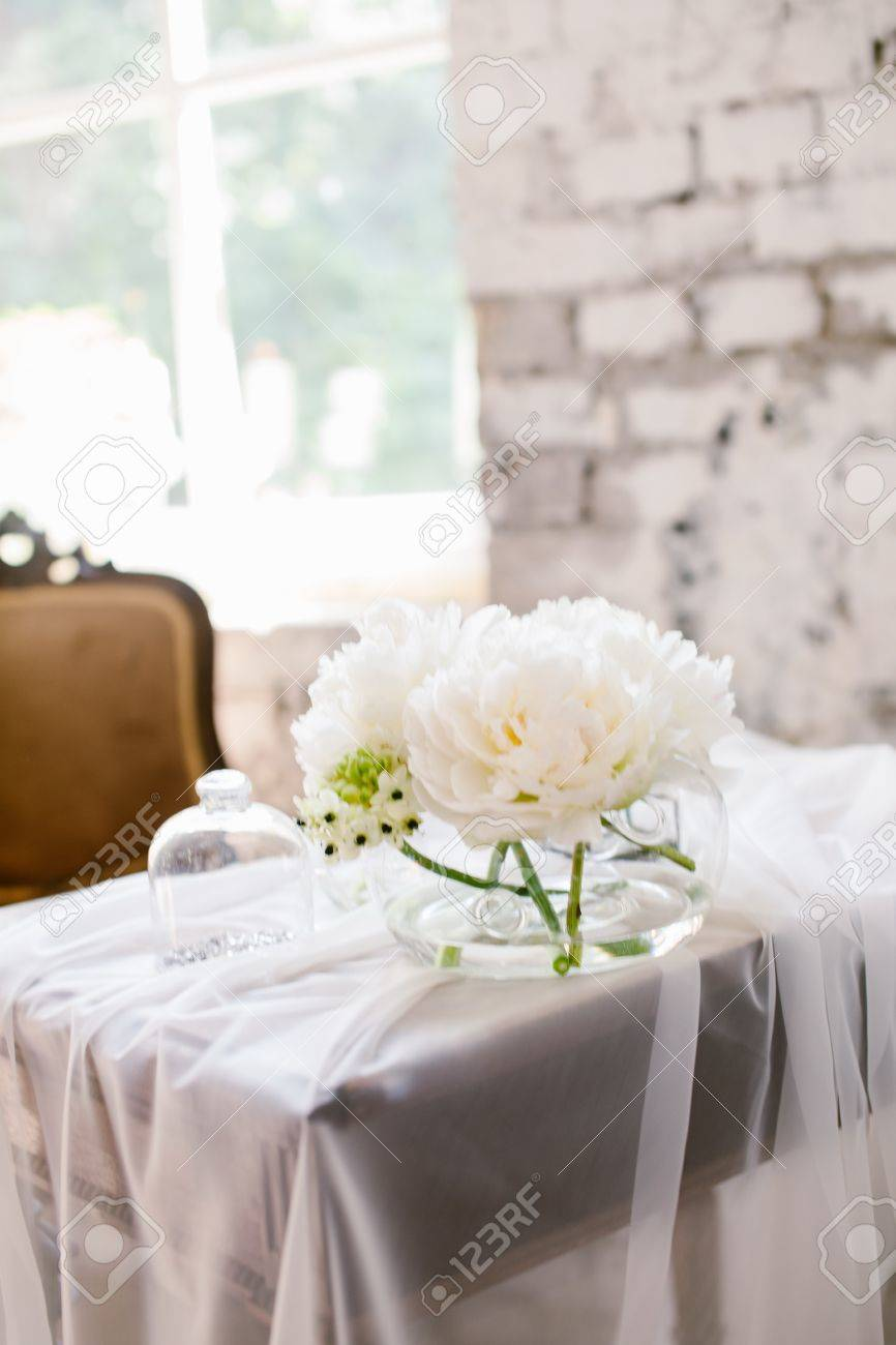 Vase with beautiful david austin roses on a table nice rare stock stock photo vase with beautiful david austin roses on a table nice rare white flowers for rustic wedding decoration loft style mightylinksfo