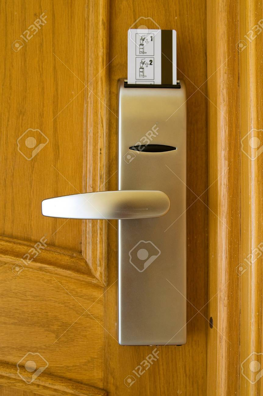 Wooden door with security card at the resort in exotic country Stock Photo - 7176516