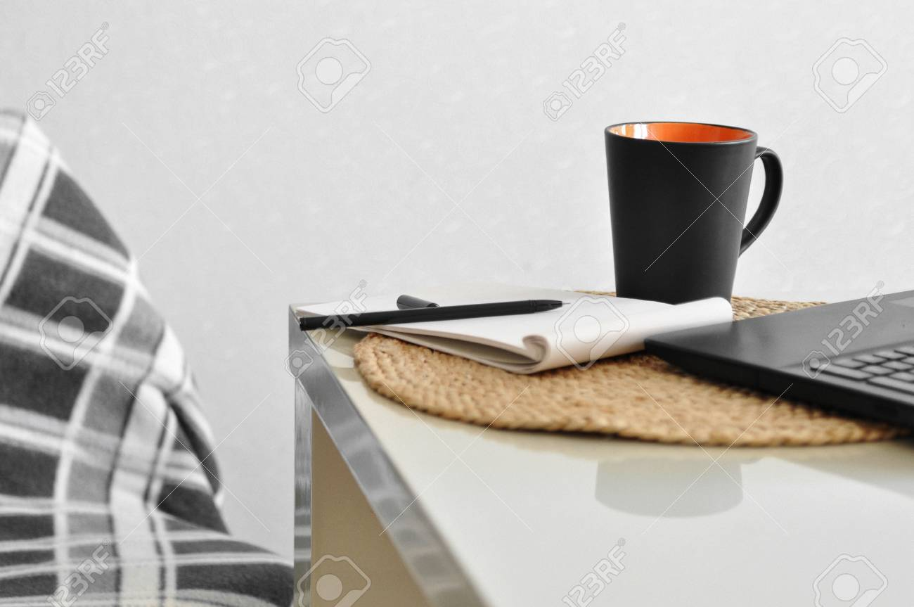 A Cozy Chair With A Blanket And A Laptop Cup Of Coffee Note Pen