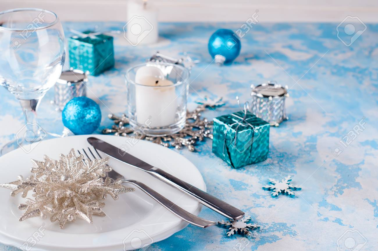 Silver And Cream Christmas Table Setting With Christmas Decorations