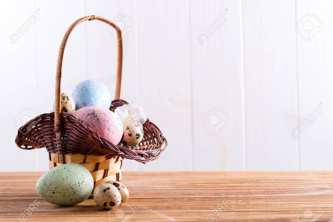 Greeting Easter Card With Wicker Basket Of Colorful Handmade Stock Photo Picture And Royalty Free Image Image 141336160