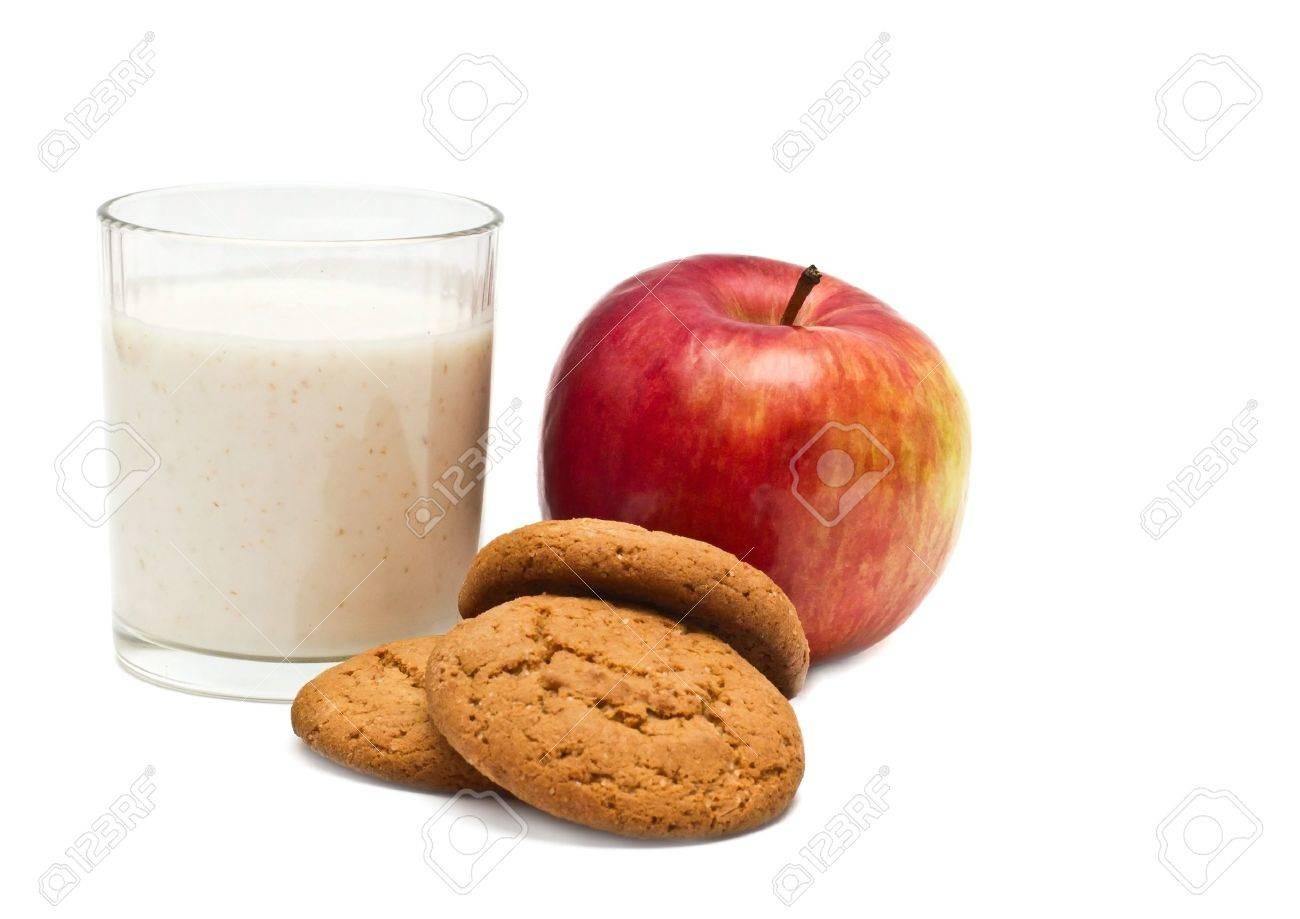 Apple, oatmeal cookies, and yogurt in a glass on a white background Stock Photo - 18247371