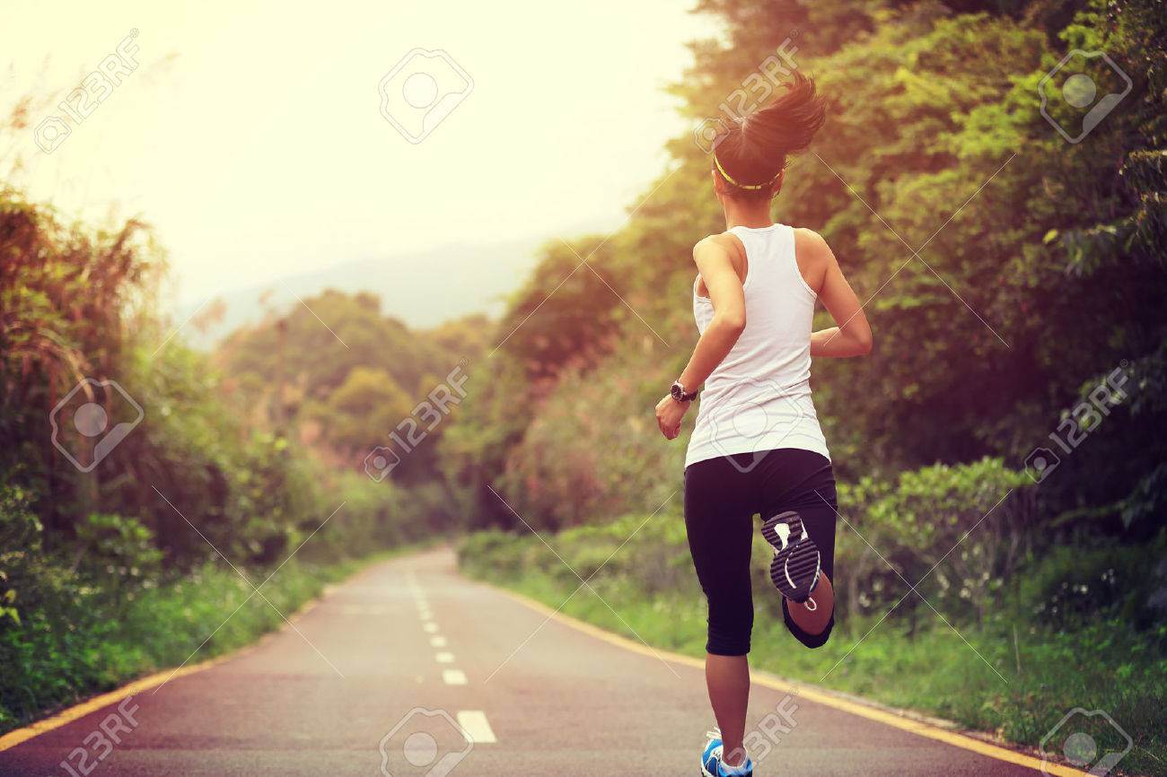 young fitness woman runner running on trail - 50049443