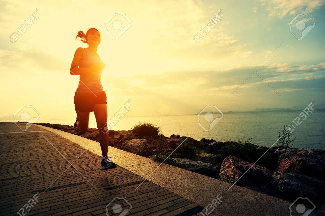 Runner athlete running at seaside. woman fitness silhouette sunrise jogging workout wellness concept. - 50504778
