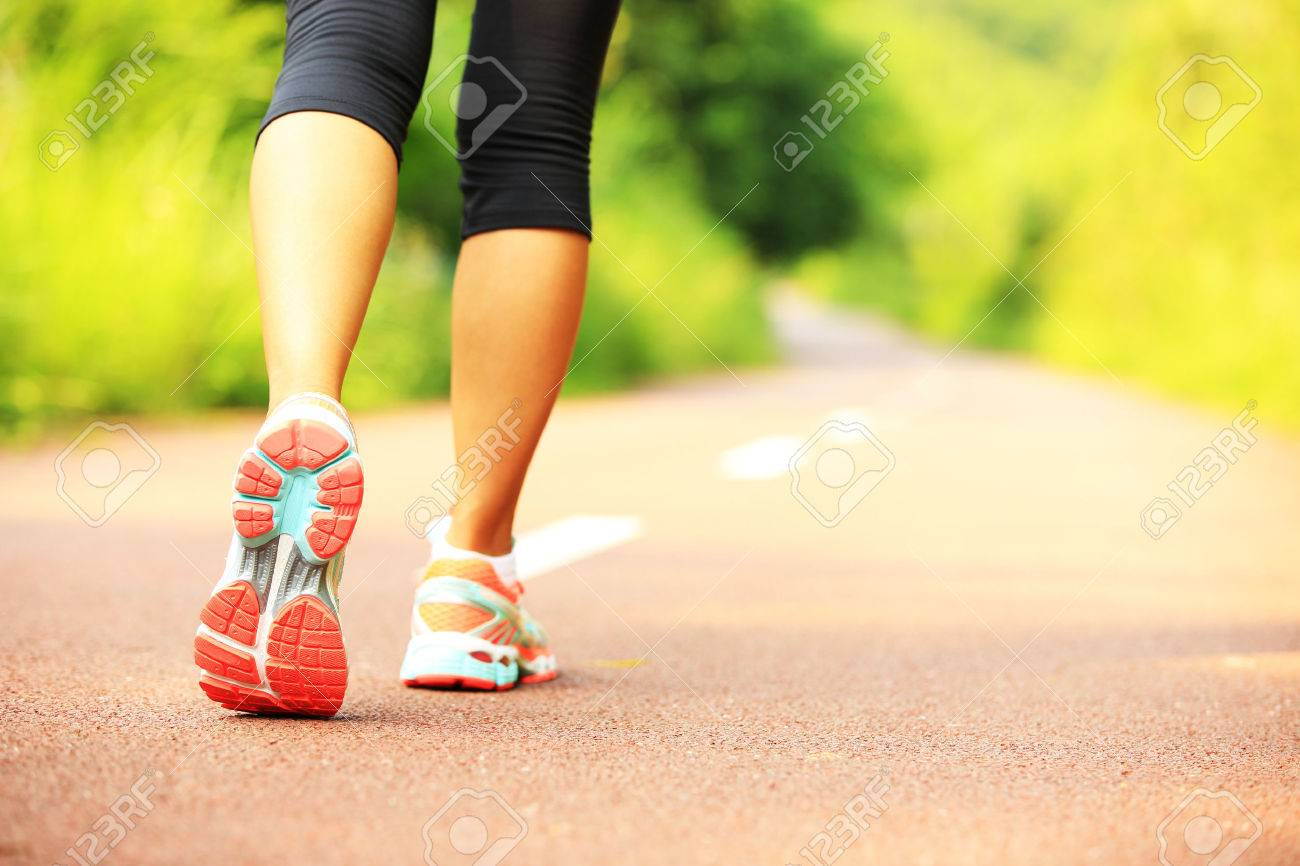 young fitness woman legs walking on forest trail - 52653173