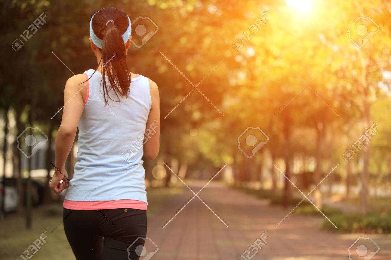 healthy lifestyle woman running at city park pavement - 51331050