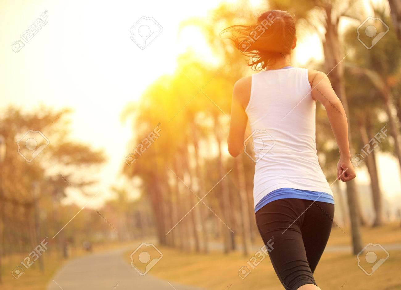 woman running at tropical park - 51285375