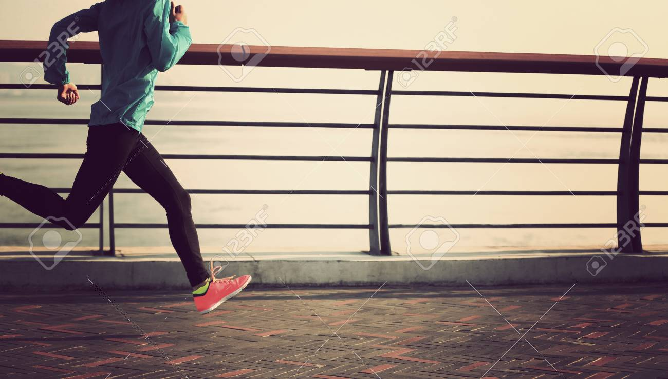 young fitness woman runner running at seaside - 52209482