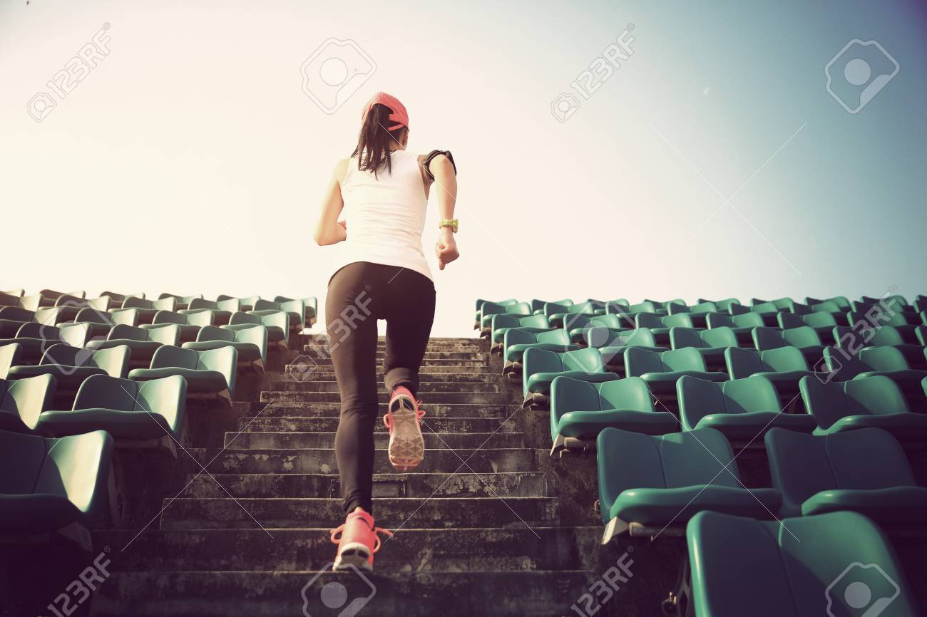 Runner athlete running on stairs. woman fitness jogging workout wellness concept. - 53359230
