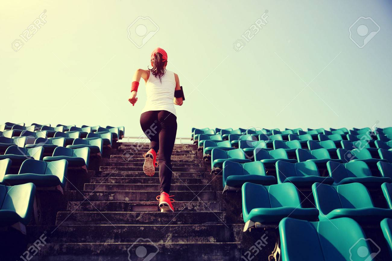 Runner athlete running on stairs. woman fitness jogging workout wellness concept. - 53425133