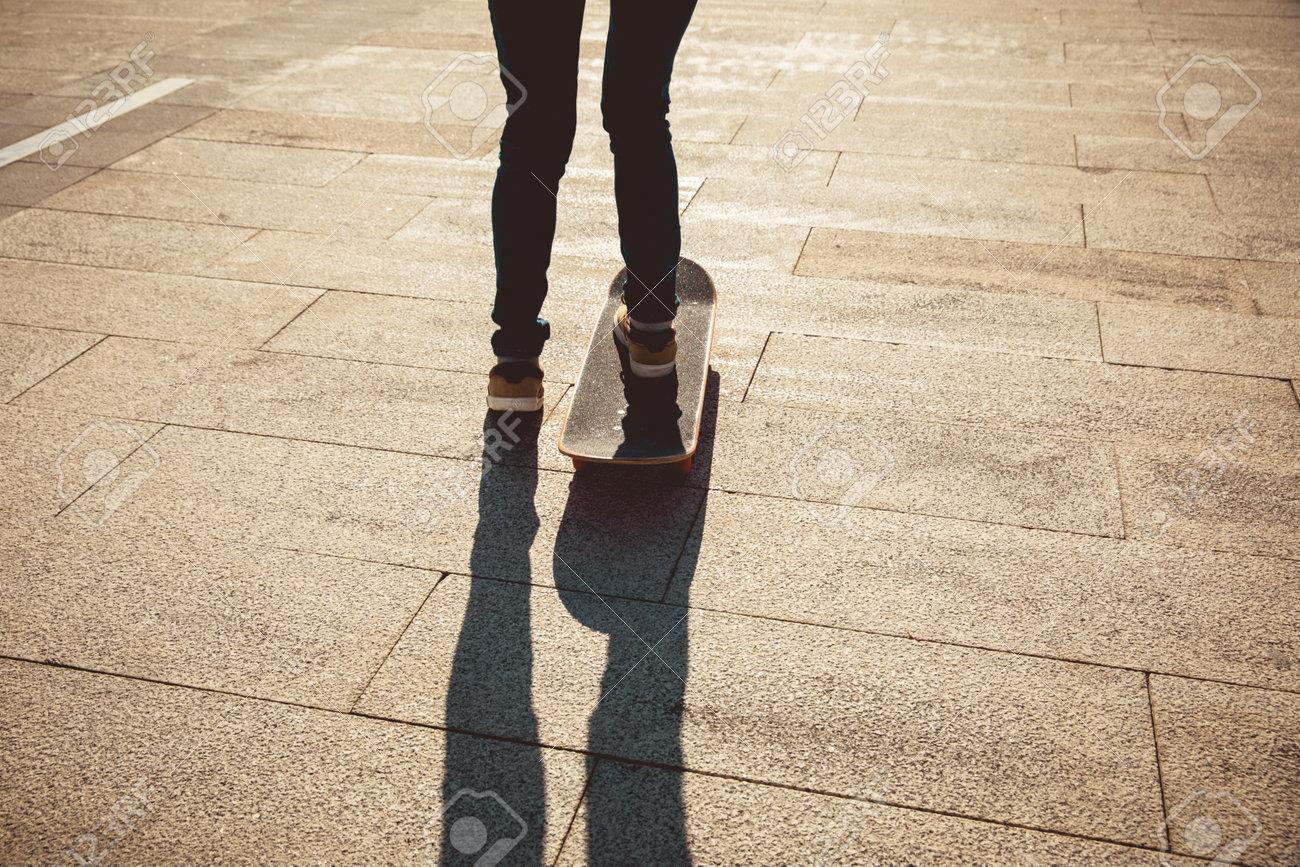 Skateboarder skateboarding outdoors on sunny morning - 166795654