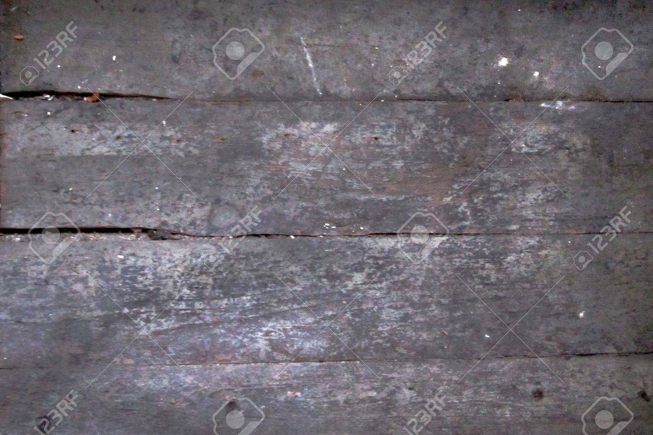Distressed wooden board surface lengthwise makes good grunge background. Stock Photo - 10414918