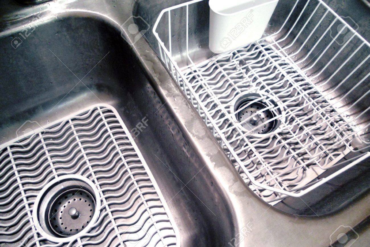 Double Bowl Kitchen Sink With White Mats And Dish Drainer
