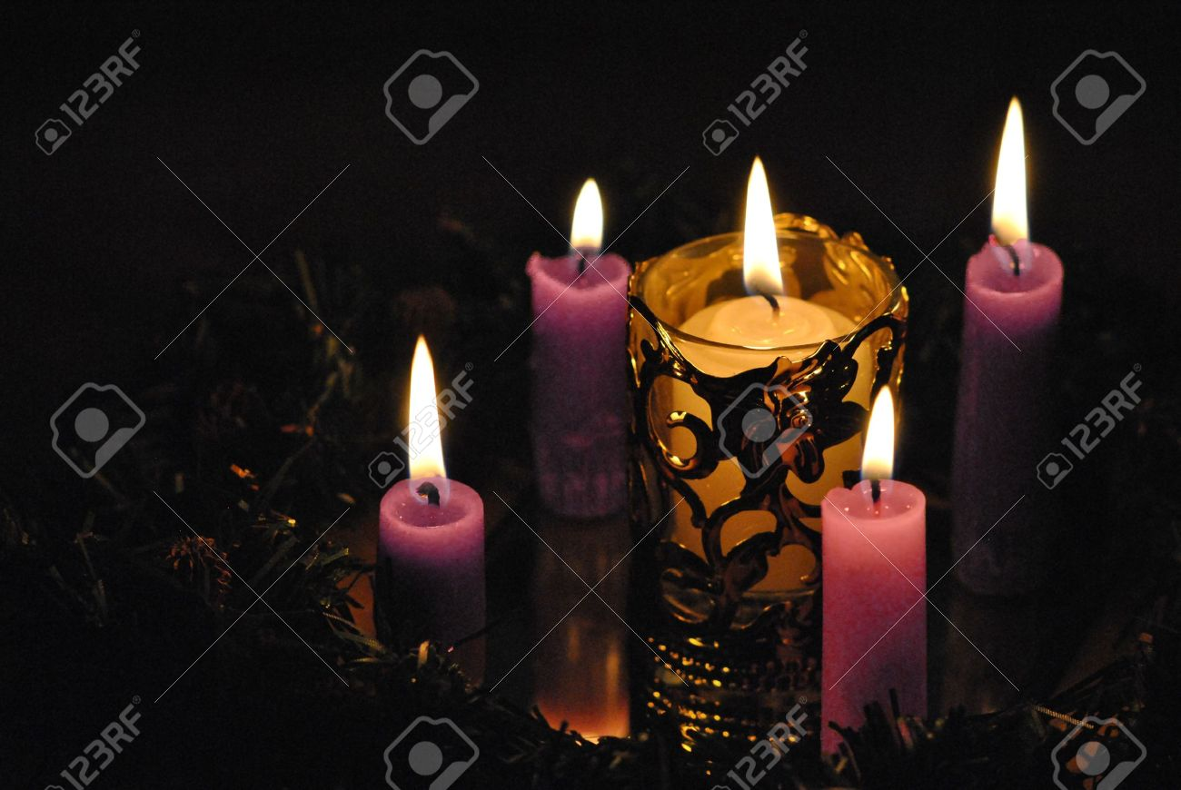 advent wreath candles three purple and one pink light the long