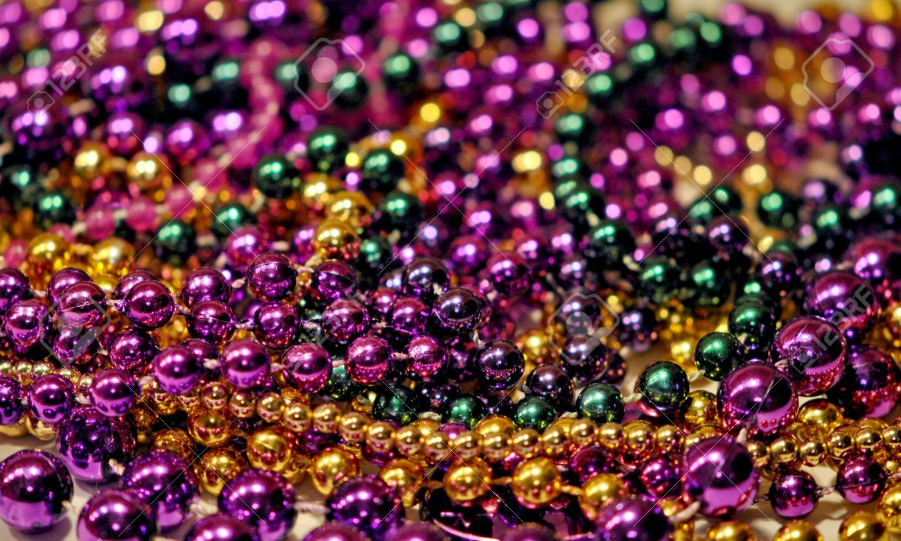 Background Of Mardi Gras Beads With Shallow Dof Stock Photo 12394420
