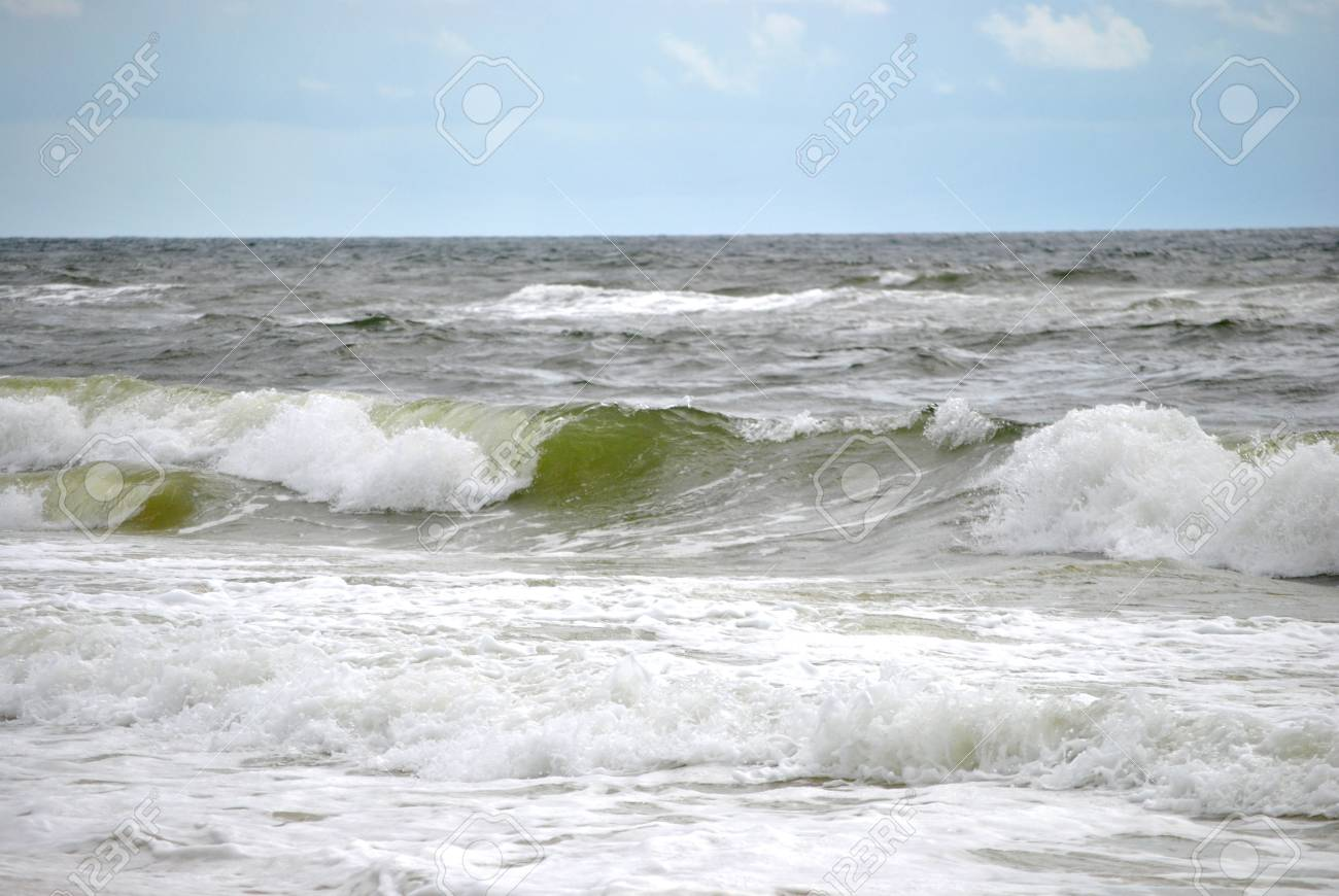Frothy waves crashiing onto the shore Stock Photo - 16026297