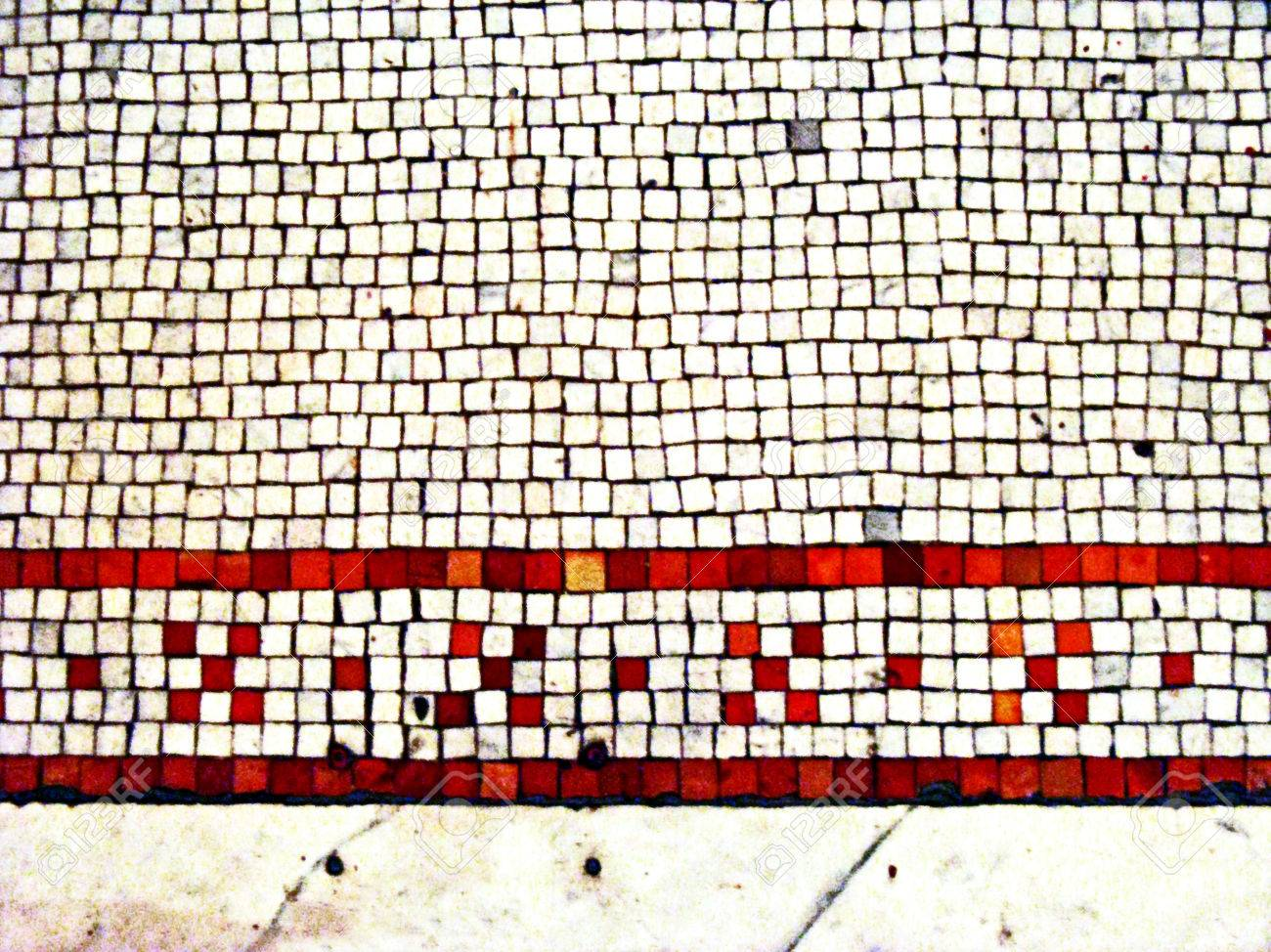 Old stone tile floor with mosaic inlay pattern in red and white old stone tile floor with mosaic inlay pattern in red and white vintage 1800s stock dailygadgetfo Gallery