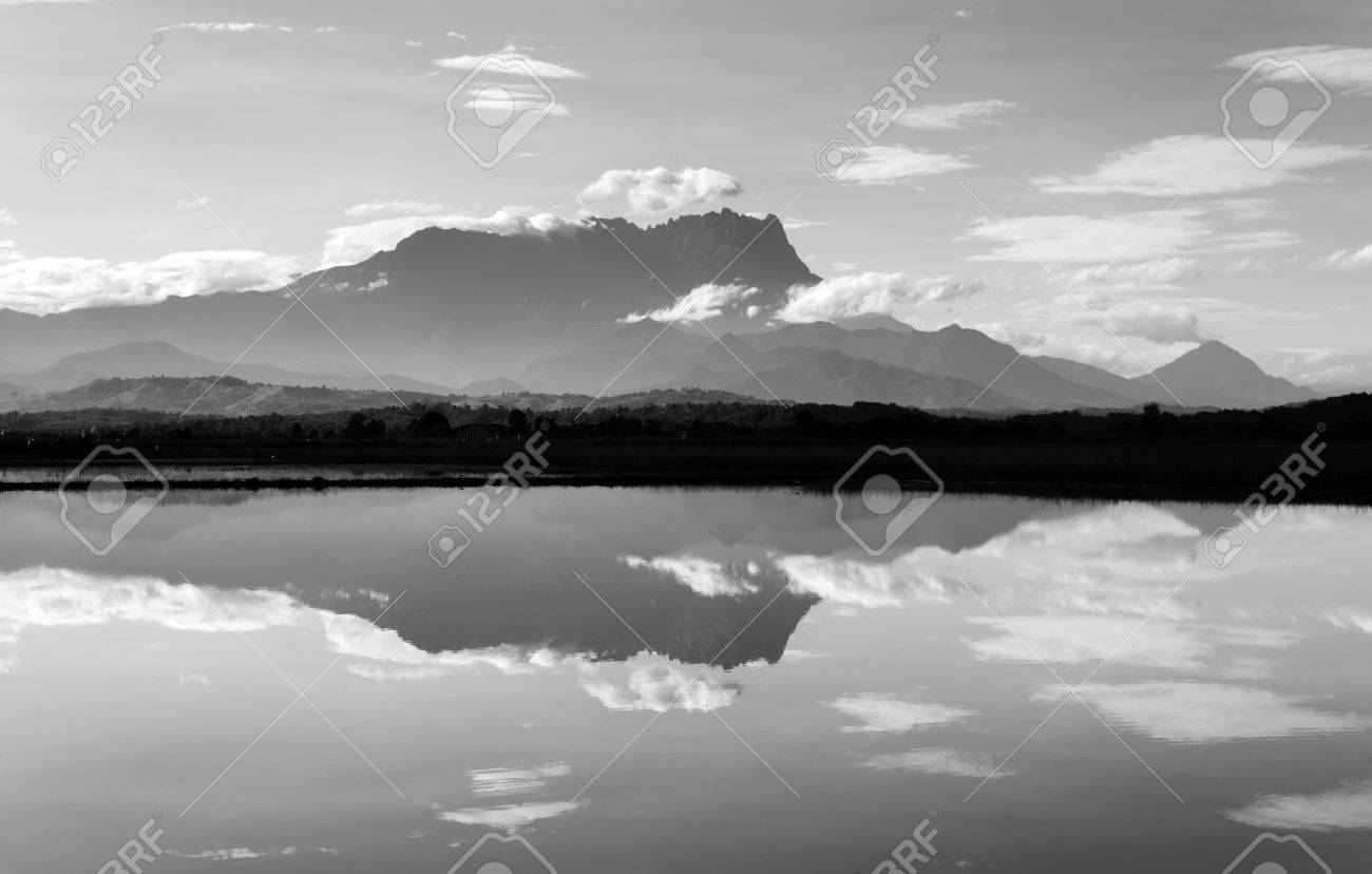 Reflection of Mount Kinabalu in black and white - 24355501