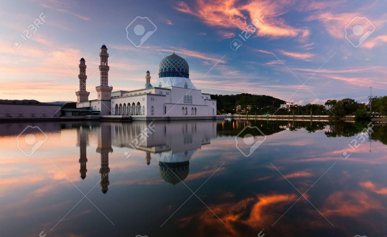 Reflection of Kota Kinabalu city mosque at sunrise in Sabah, East Malaysia, Borneo - 30891781