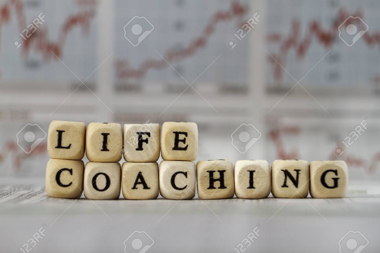 Life Coaching word built with letter cubes on newspaper background - 39316908