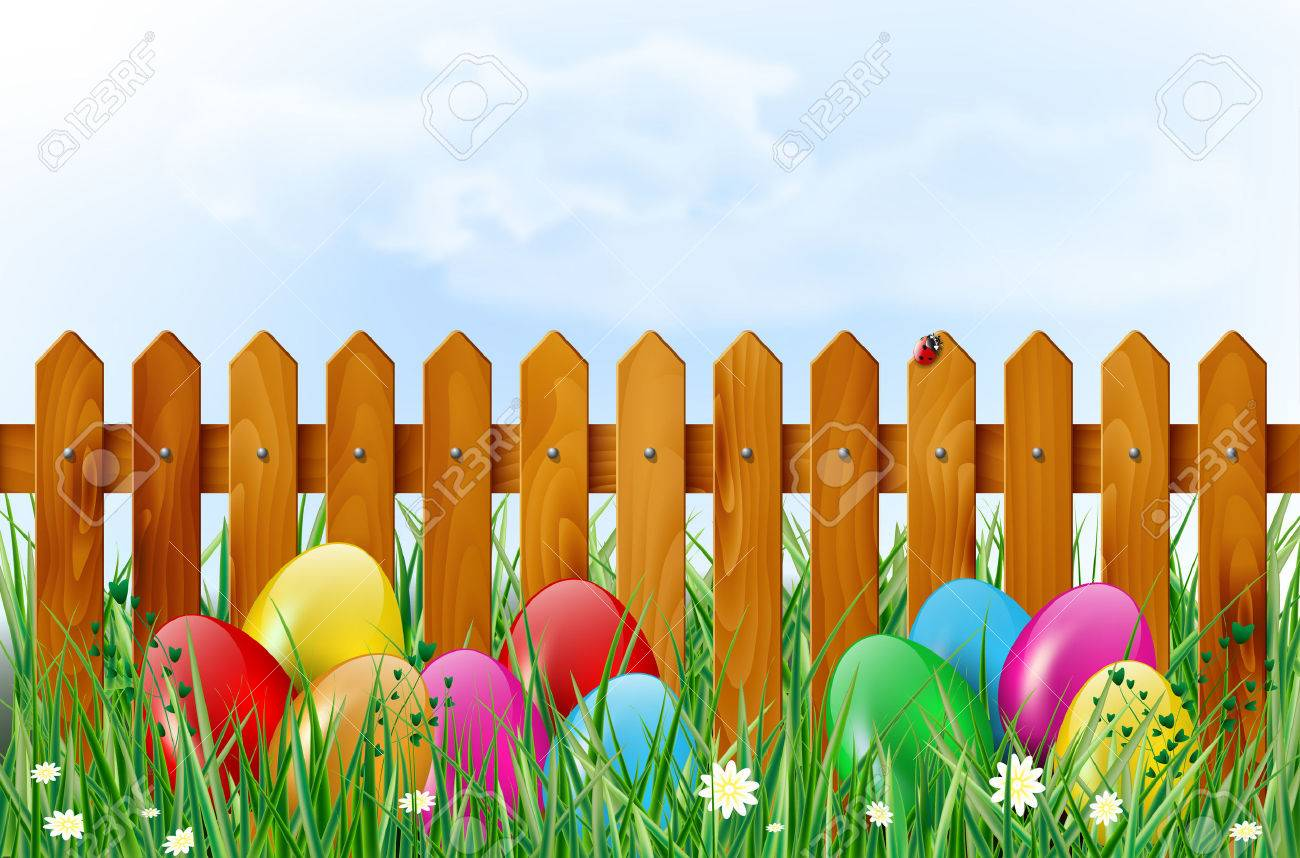 Easter Background With Eggs Wooden Fence Sky Grass And Flowers