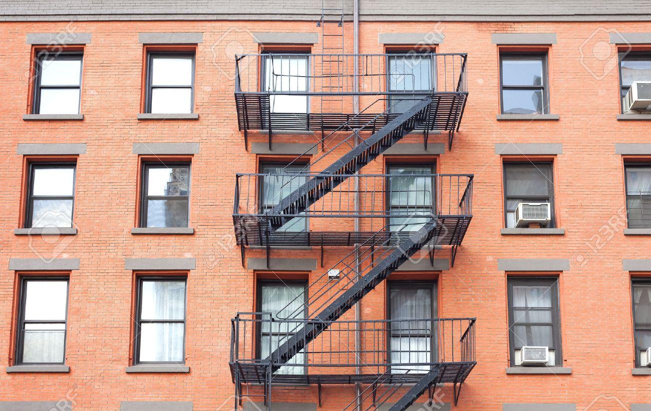 Apartment Building Fire Escape Ladder fire escape ladders, brick building in new york, usa. stock photo
