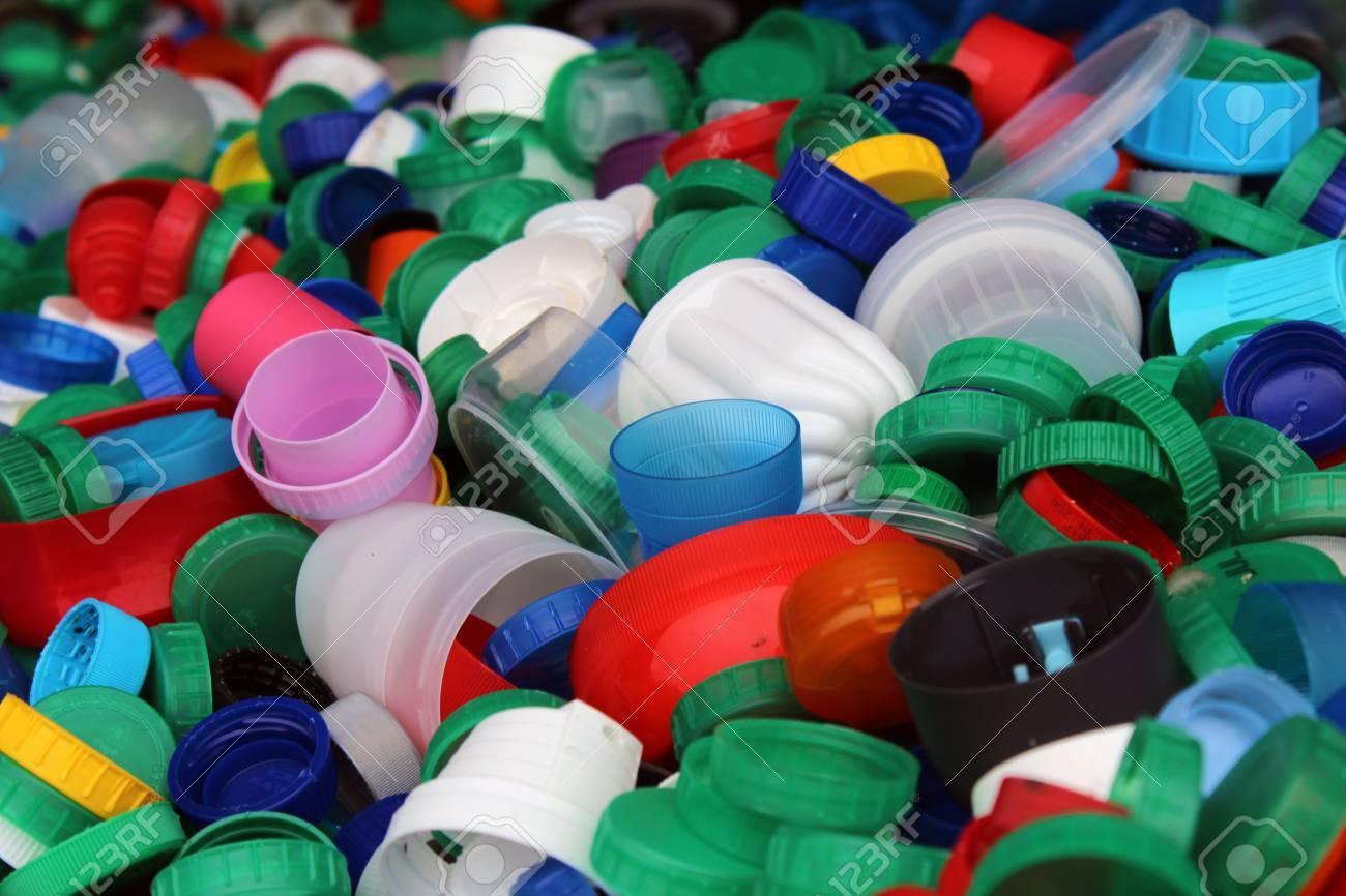 Plenty of colorful plastic bottles tops