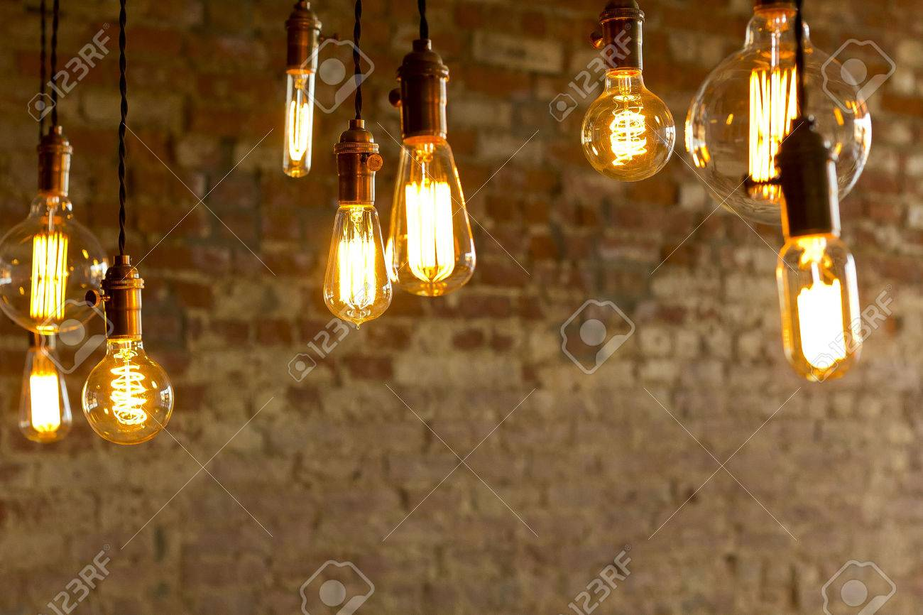 Decorative antique edison style light bulbs against brick wall background Stock Photo - 37347858