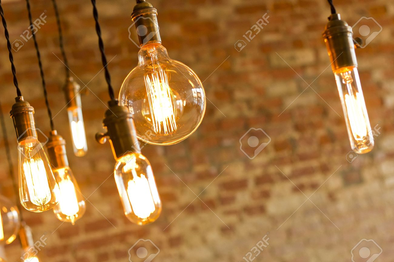 decorative antique edison style light bulbs against brick wall background stock photo 37347873 - Decorative Light Bulbs
