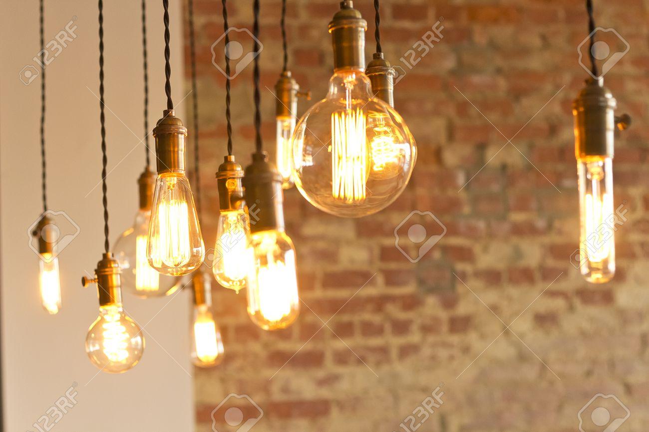 Decorative antique edison style light bulbs against brick wall decorative antique edison style light bulbs against brick wall background stock photo 37347874 arubaitofo Choice Image