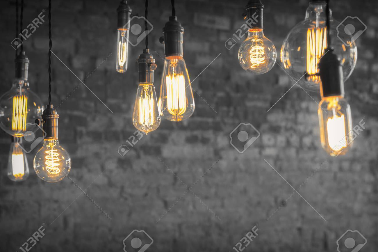 Decorative antique edison style filament light bulbs against brick wall Stock Photo - 42134155