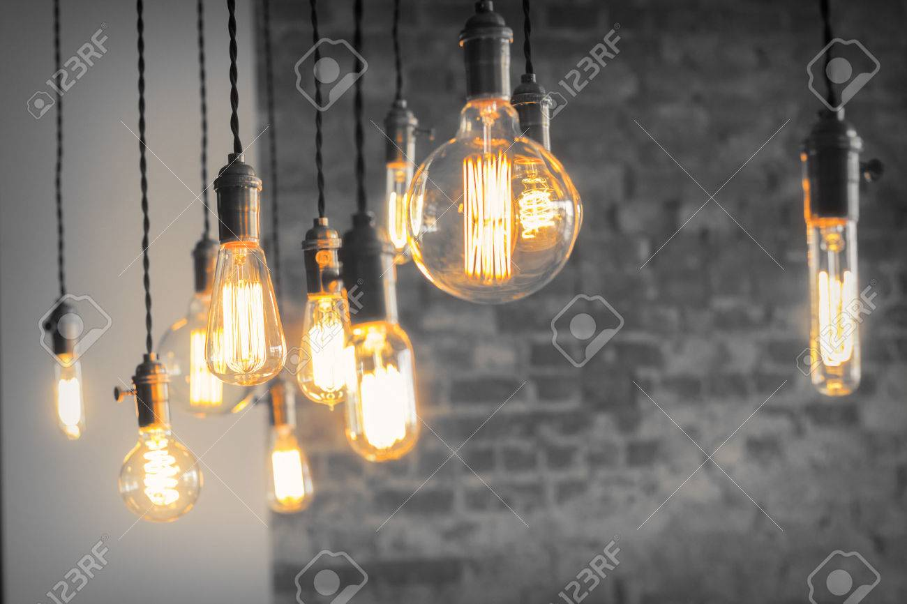Decorative antique edison style filament light bulbs against brick wall Stock Photo - 42134200