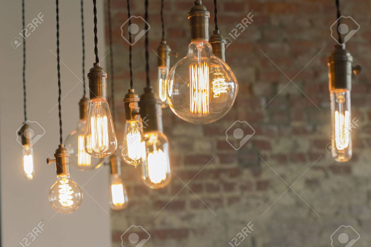 Decorative antique edison style filament light bulbs against brick wall Stock Photo - 42134201