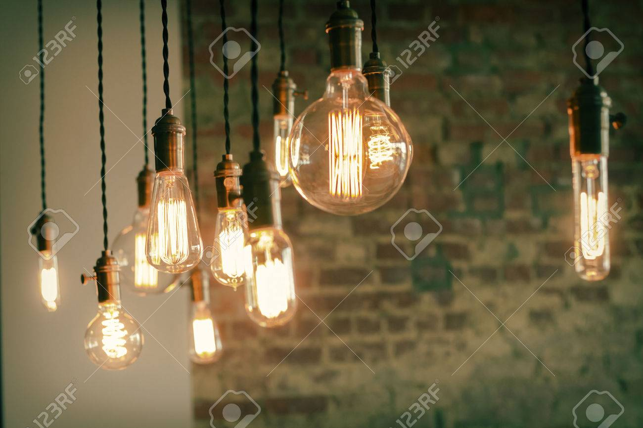 Decorative antique edison style filament light bulbs against brick wall Stock Photo - 42134206