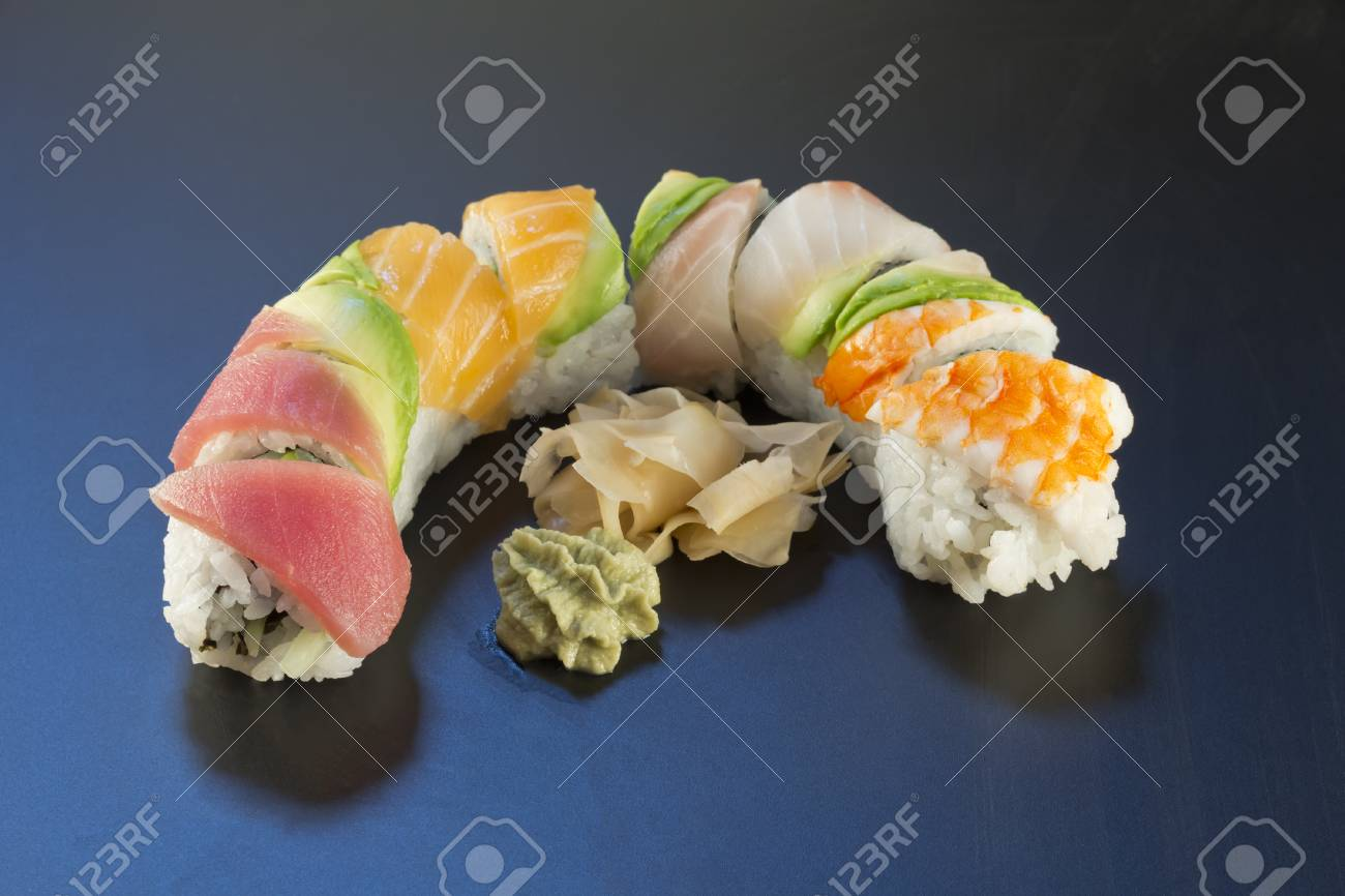Rainbow Sushi Roll Sliced With Wasabi And Fresh Ginger Stock Photo