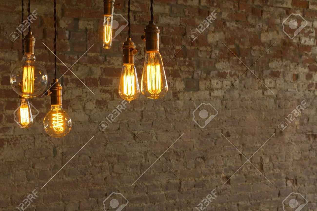 Decorative antique edison style light bulbs against brick wall background Stock Photo - 47181832