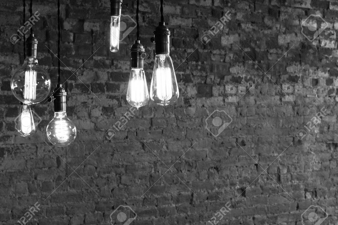 Decorative antique edison style light bulbs against brick wall background Stock Photo - 48915003