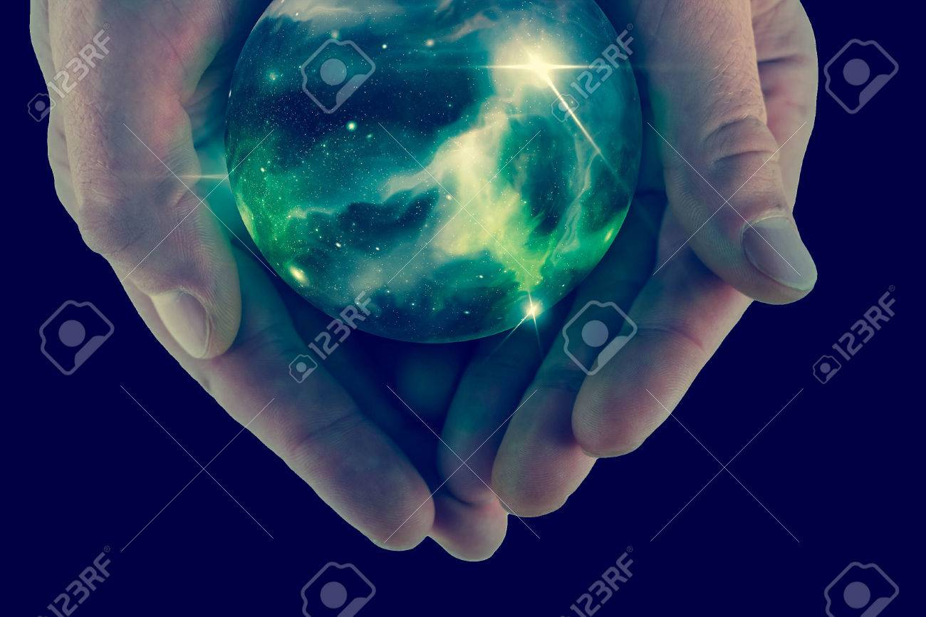 Holding the universe in fortune teller magic crystal ball Stock Photo - 48916067