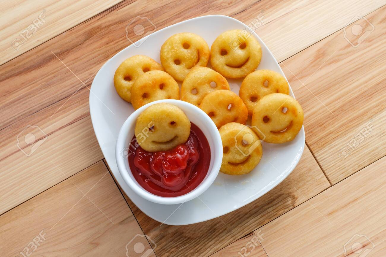 Happy French fried potato smiley faces with ketchup - 133760201