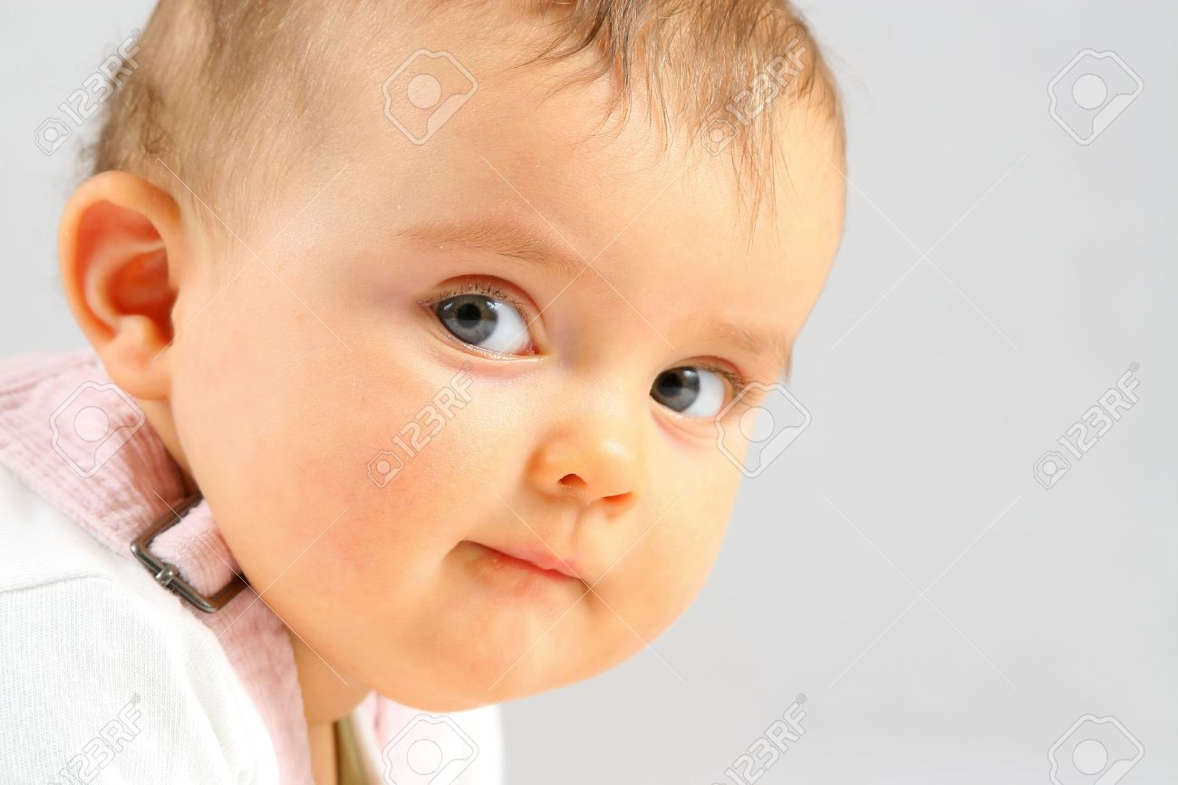 nice small baby girl looking at the camera stock photo, picture and