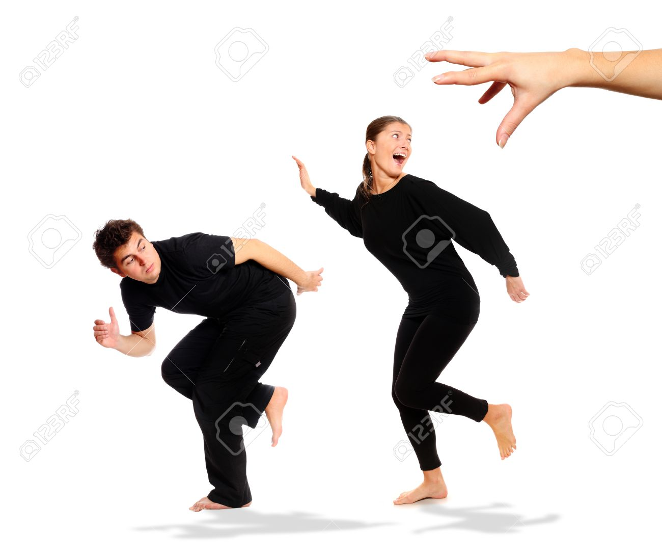 A picture of young couple running away from big hand, a lot of conceptual meanings Stock Photo - 8407119