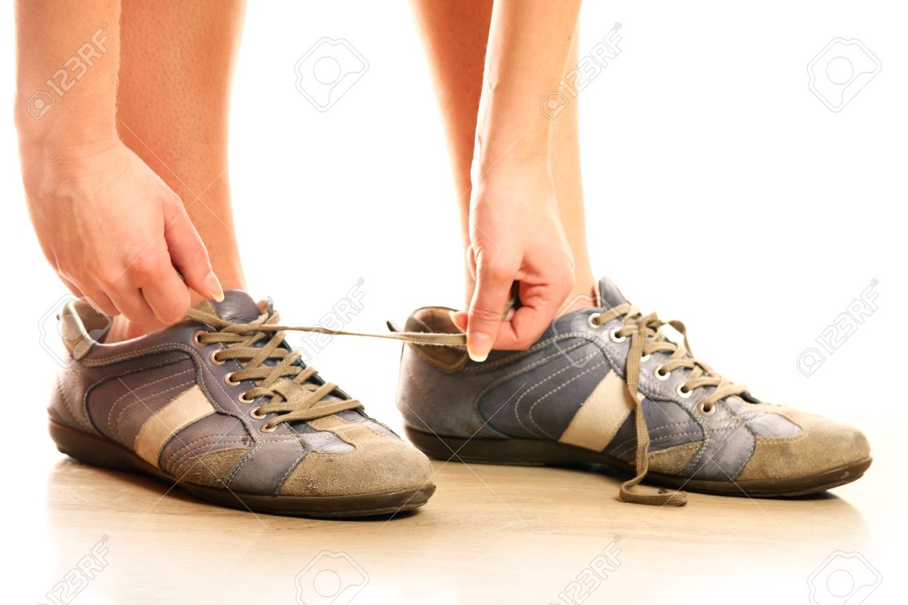 Background image too big - A Close Up Of A Person Lacing Up Too Big Shoes Over White Background Stock