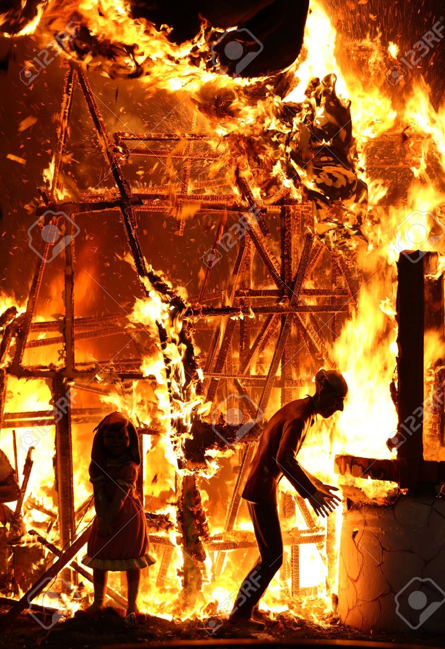 A Picture Of A House On Fire And Two Mannequins Inside Stock Photo   9112911